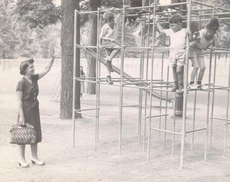 A woman waved to her son mike as he played in the Boston Common playground.